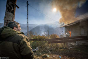 Man burning his house left in the Azerbaijani side
