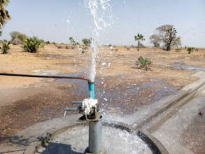 Water sprays from a newly constructed well