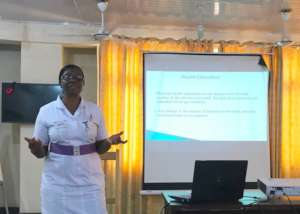 Head Nurse Gifty giving presentation