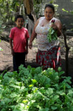 Woman and her son showing their radish crops