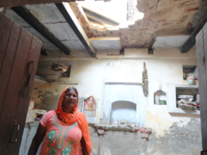 Mama Wati and the collapsed roof