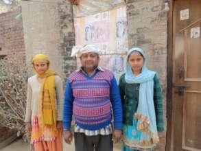 Babita and Savita with their father, Birbal.