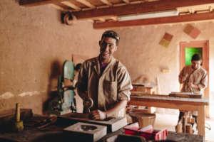 Train eight young Berber men in woodworking skills