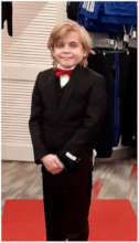 Wish kid Eric in his black suit and red bowtie