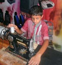 Ahsan sowing car seats at a car workshop
