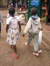 Girls walking through Kibera