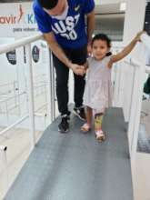 Amelia takes her first steps in her new prosthesis