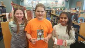 Students with Carl's picture and thank you note