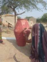 Poor women making Nadi hole