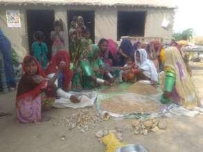 Women making sand smaples