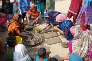 Women making bricks for stove making