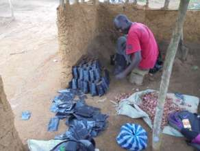 Filling bags with soil to plant tree seeds