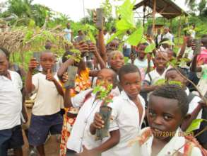 Students receiving seedlings to plant at school