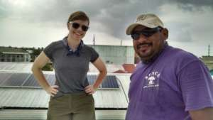 Volunteer and staff examine existing solar