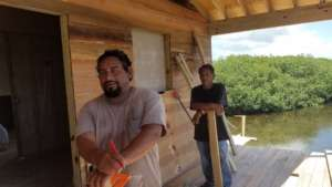 Local Belizeans working on school housing