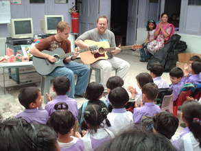 Todd And Tim Shea Singing With Pakistani Children