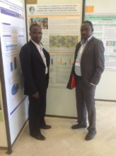 Drs. Kone and Tounkara with the GAIA poster