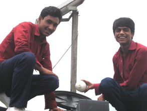 Two students purifying their school's water supply