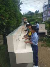 Students using drinking water station