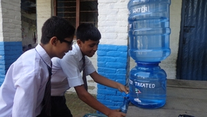 Students using chlorinate water in School