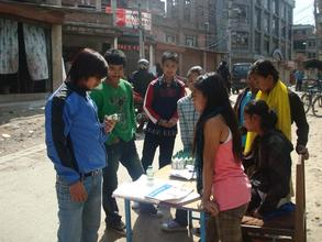 Student disseminating information through stalls