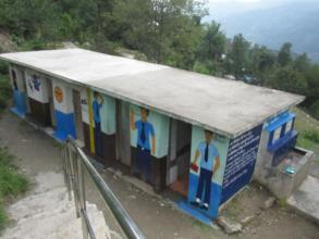 Painted toilet along with hand washing station