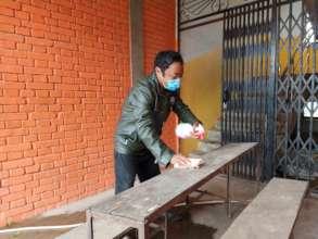 Sanitizing a school bench