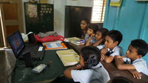 Schoolchildren and teacher watching AniBook story