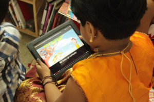 Child reading with an AniBook on a tablet