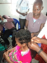 GIrls in hairstyle training at Children's Voice