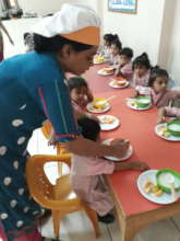 Kitchen in charge helping students