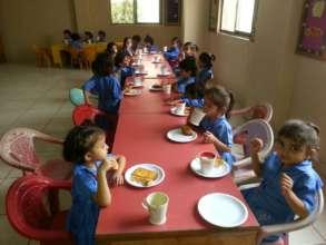 Children eating French toast in Kindergarten