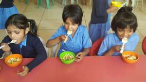 chowing down on chickpea salad with fruits