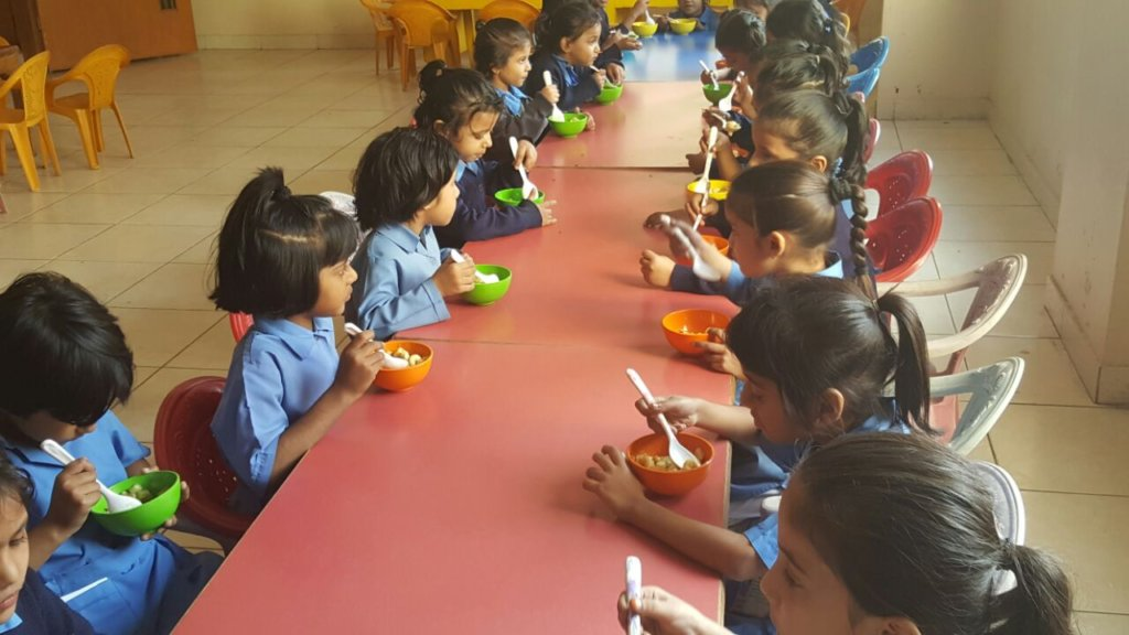 Breakfast for Kindergarten schoolgirls in Pakistan