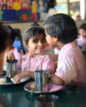 Breakfast for Kindergarten schoolgirls in Pakistan