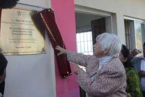 NYF Founder Olga Murray unveiling the new NLC sign