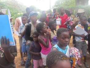 Kids In Rimbi Village Receiving School Supplies