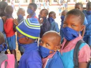 Distributing Masks To Rimbi Primary School