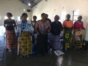 Women singing and praying to kick off a