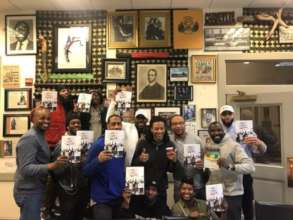 "Reentry Book Club poses with ""Our Lives Matter"""