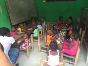 The younger children enjoying their Easter dinner