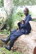 Female chimpanzee with caretaker, Mokonzi