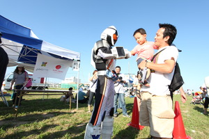 A handshake at an event in Soma City - AAR Japan