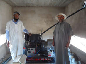 Community members and irrigation machinery