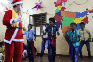 Father Christmas dancing with the DSH children