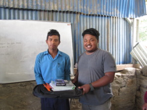 A student receives educational kit from ECCA