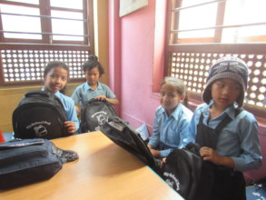 Students with the school bag containing stationery