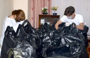 Irina & Vlad Mark Names on Donation Bags