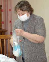 Feodora Prepares Sanitary Packet