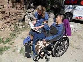 Volunteer Ruth reading to Jose